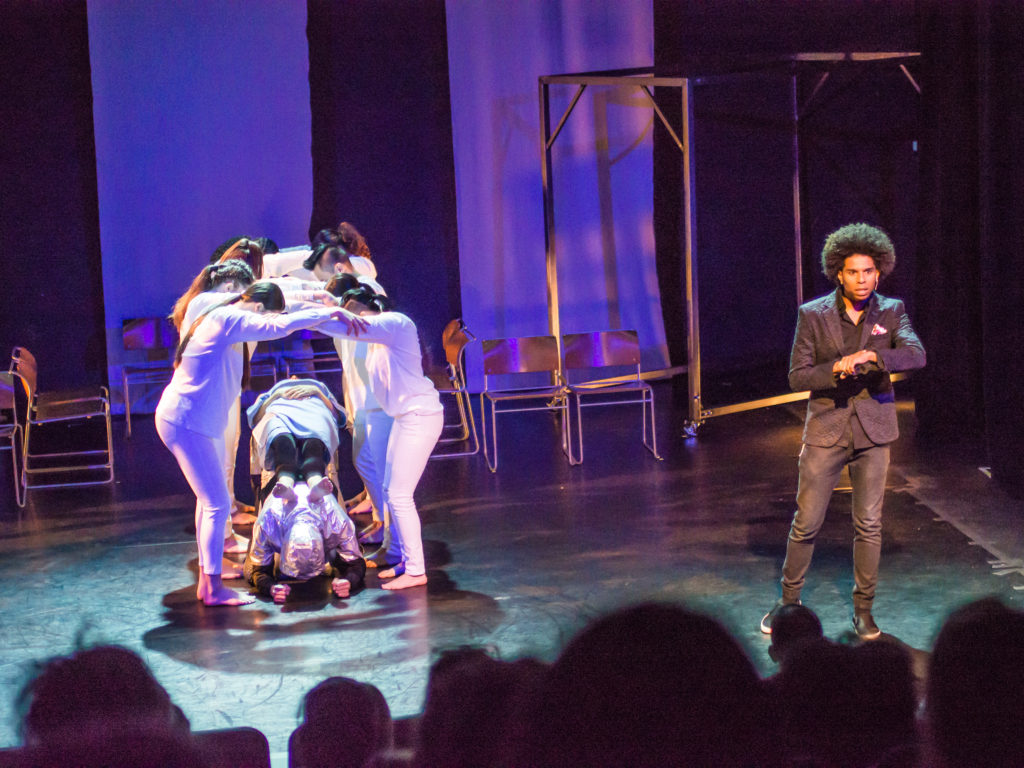 "Group of EPIK Dancers assemble together to create an arch over ""Kat"" to symbolize an MRI machine."